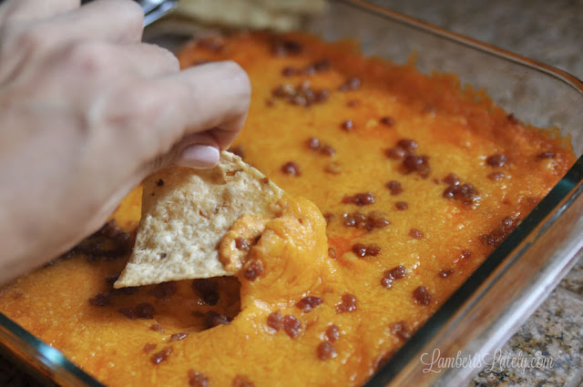 This recipe for Bacon Buffalo Chicken Dip is so easy for gameday! It has all of the flavors your guests love: ranch, cheddar, chicken, and just the right amount of heat.