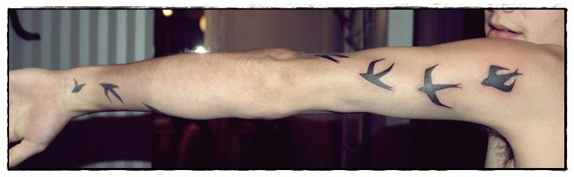 risti tatuointi käsivarressa