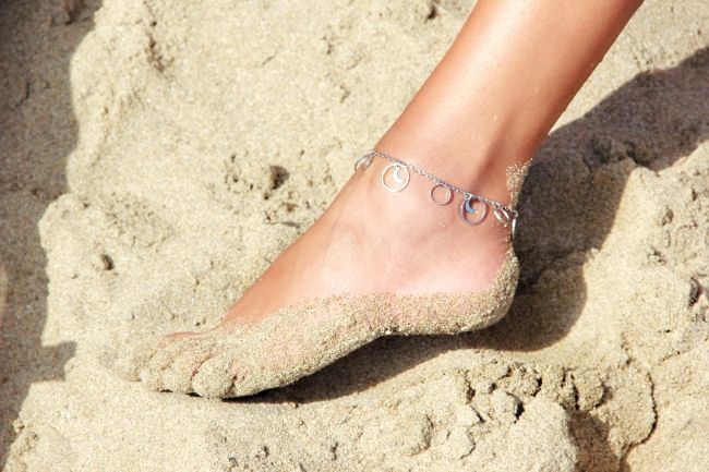 silver ankle bracelet with circles and moons