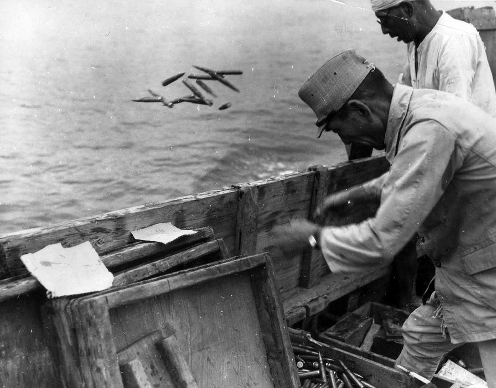 Japanese ammunition being dumped into the sea on September 21, 1945. During the U.S. occupation, almost all of the Japanese war industry and existing armament was dismantled.