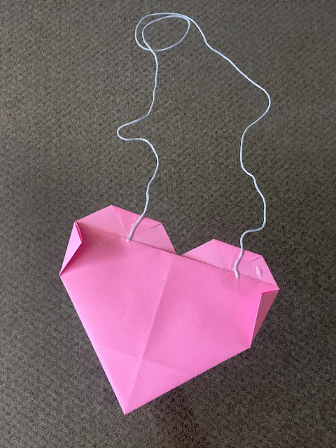 Attaching the thread to our Origami Heart.