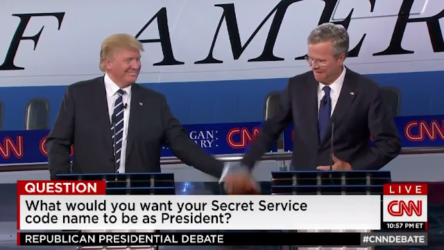 Jeb Bush Donald Trump debate hand low-five slap