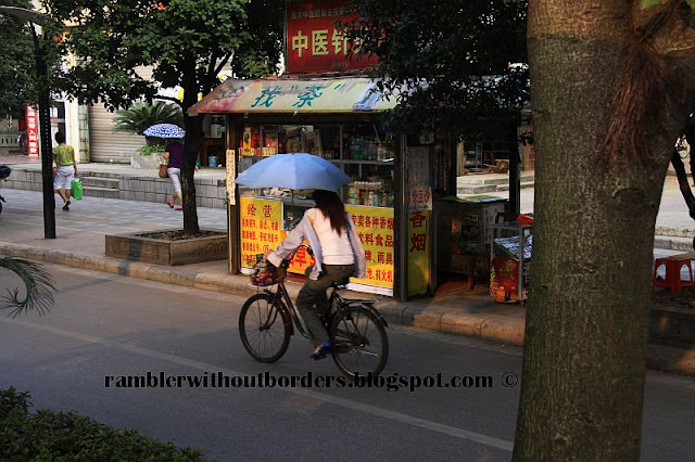 Biclycle with umbrella, Guilin, China