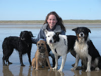 Portrait of Dr. Carri Westgarth with four dogs