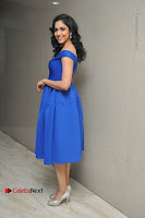 Actress Ritu Varma Pos in Blue Short Dress at Keshava Telugu Movie Audio Launch .COM 0028.jpg