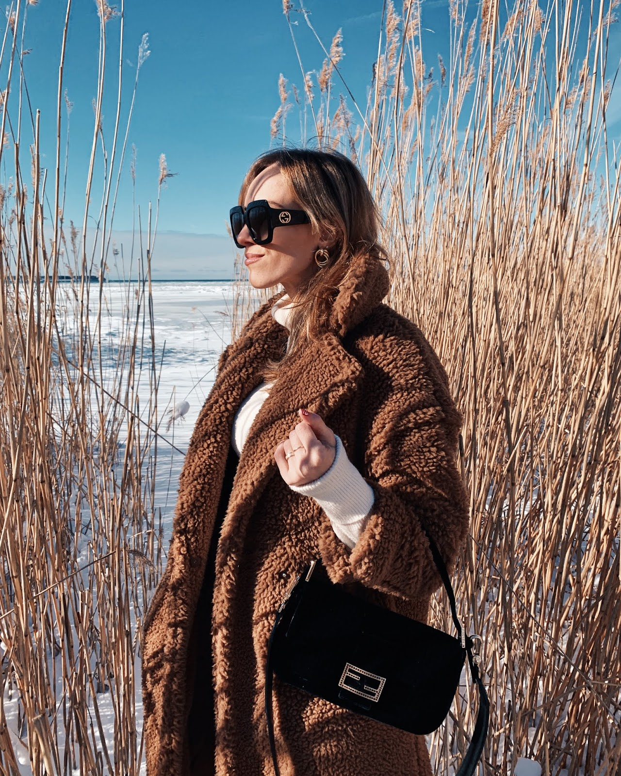 teddy coat gucci oversized sunglasses fendi baguette bag outfit