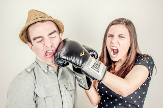 woman in a relationship boxing her partner