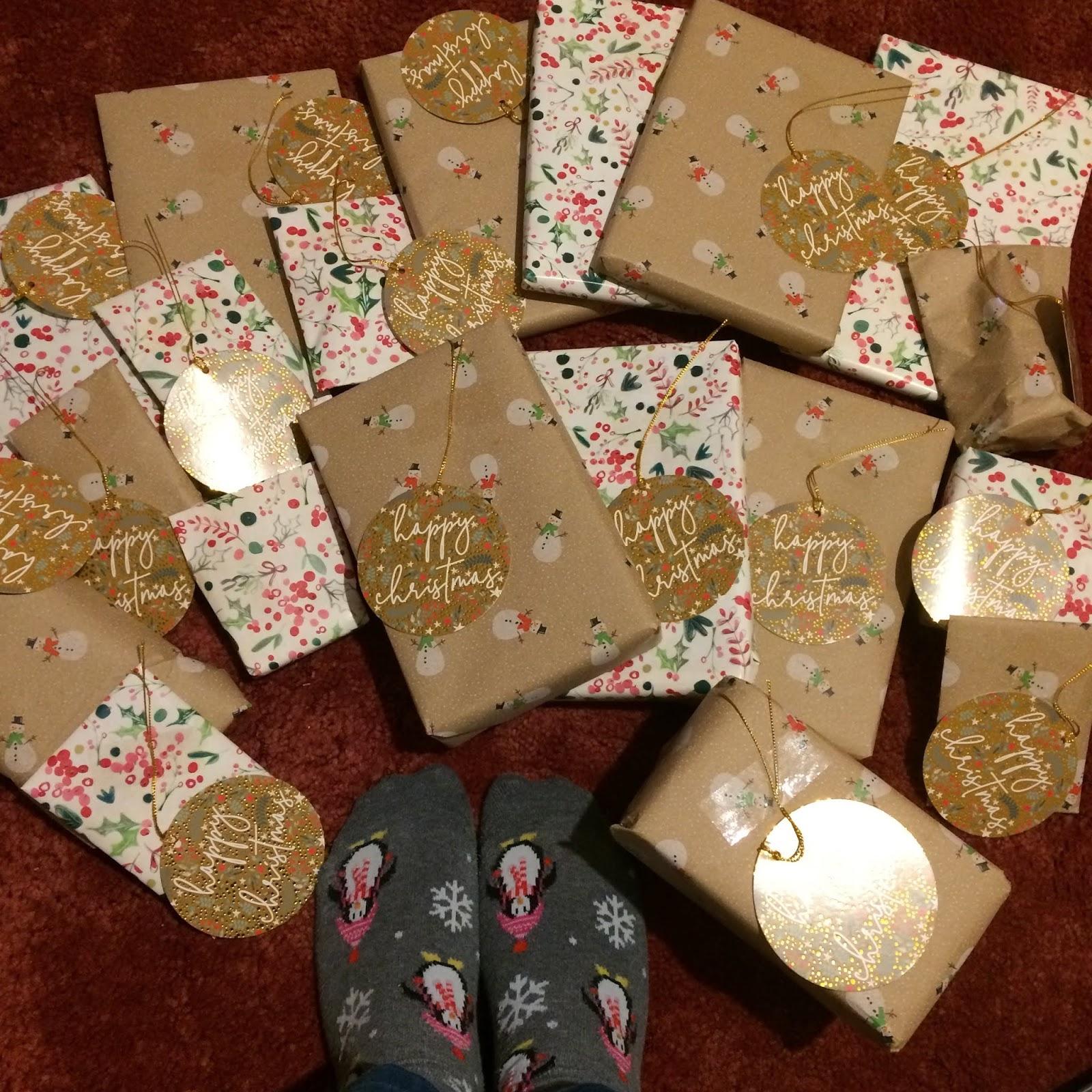 My TBTBSanta presents spread out on the floor, including my feet.