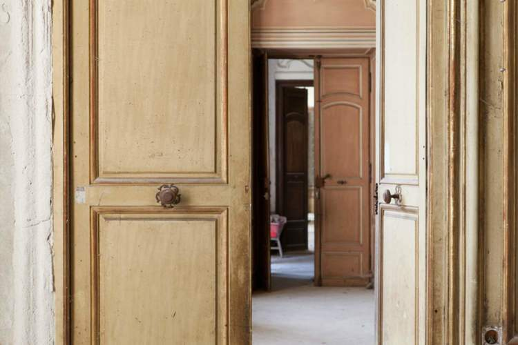 Close up detail of antique wood doors in French Chateau de Gudanes