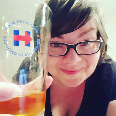image of me holding a Hillary Clinton branded glass and smiling
