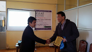 Principal of Kathford, Dr. Madhusudan Kayastha providing Token of Love to Guest Speaker of Program ,Deepesh Man Shakya (Xilinx Inc, Ireland).