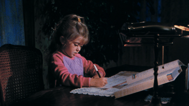 little girl puts the finishing touches on her first novel, The Crayon Diaries