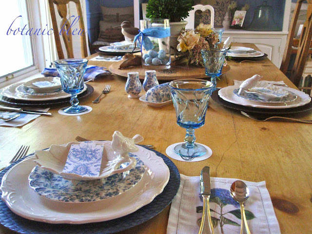 Table set with blue and white dishes on refinished old English pine table