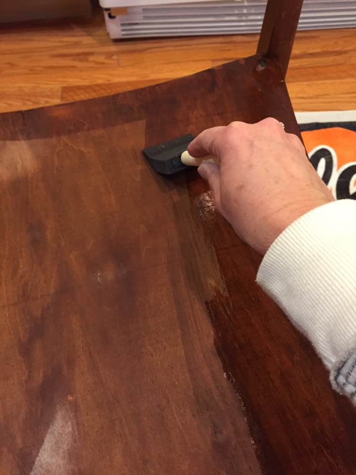 Apply two thorough coats of shellac to prevent bleed through