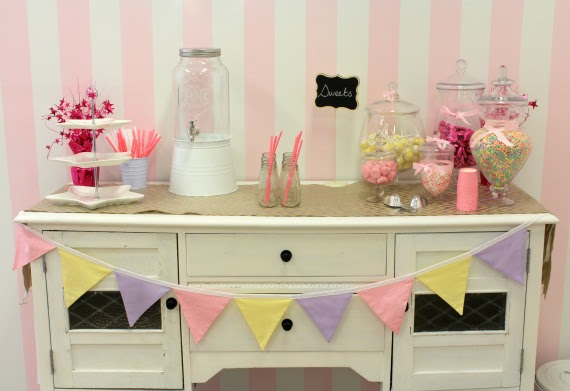 Image of lolly buffet in glass jars on vintage dresser birthday party venue