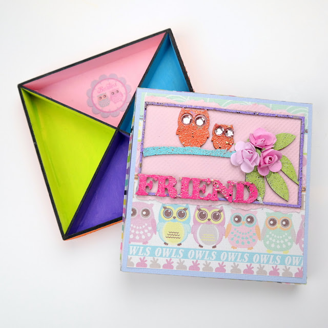 Colorful Acrylic Paint and Clear Stickers on a Gift Box by Dana Tatar