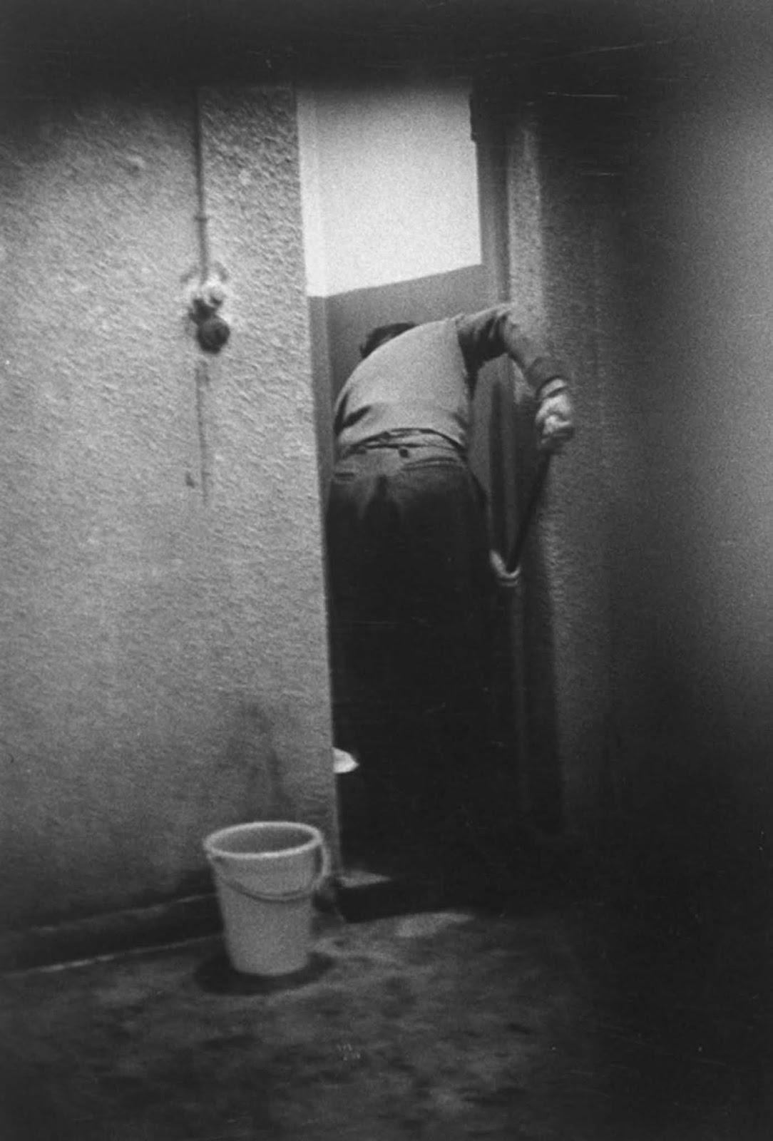 Doing chores, Eichmann mopped the bathroom floor in his jail near Haifa.