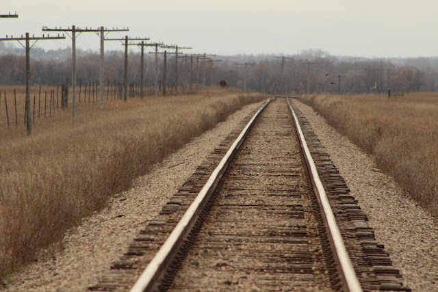 train tracks through prairie