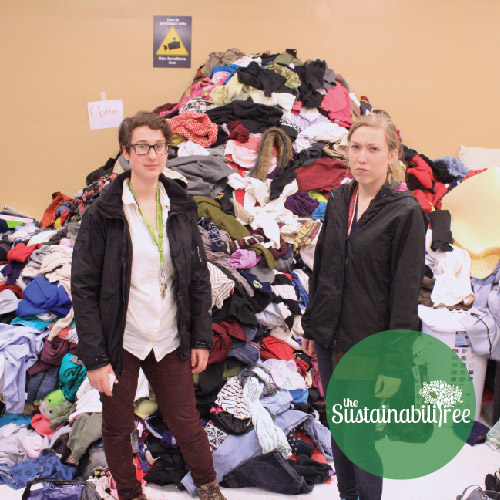 The Free Store coordinators stand in front of a pile of clothing donations for the Dump and run
