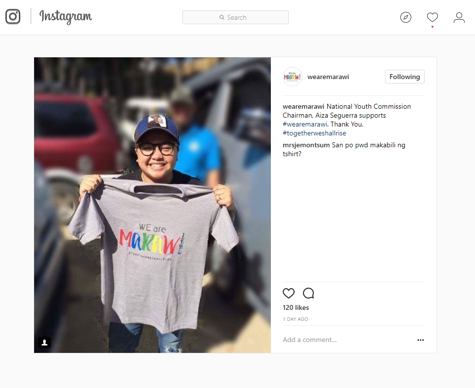 Aiza Seguerra holding We are Marawi t-shirt