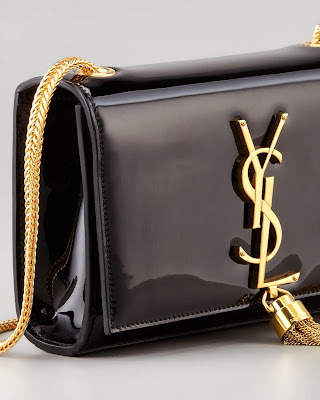 e2414492bf59e Hedi Sliman pays tribute to the rich history with Monogramme clutch bag. It  is perfect statement piece which will match classic outfits.