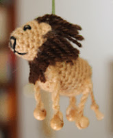 http://www.ravelry.com/patterns/library/miniature-lion-africa-series