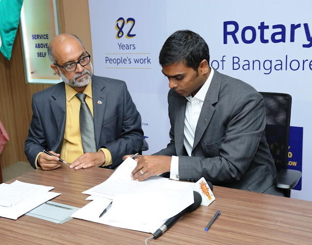 MOU Signed between AXA and Rotary Club of Bangalore- From Right Solomon Devaraj, Chief Corporate Responsibility officer (India), AXA Business Services and Rtn. President Rangarao