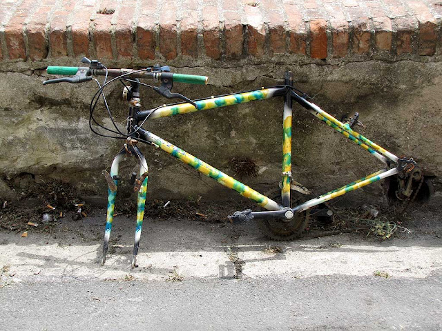 Wheelless bicycle, abandoned against a parapet, Livorno