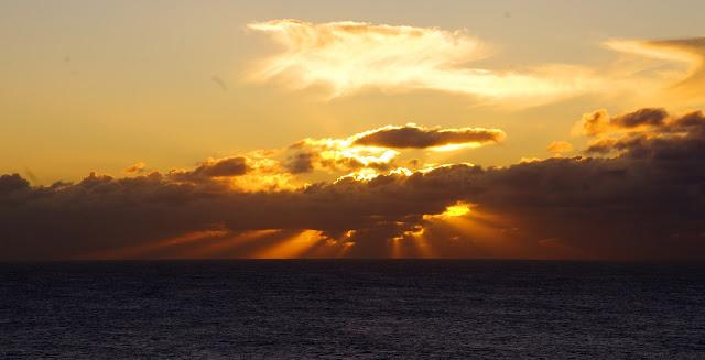 Sunrise bursting around the clouds