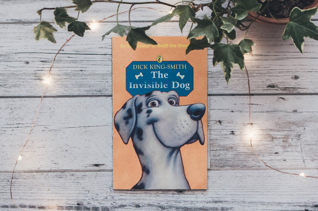The Invisible Dog by Dick King-Smith surrounded by fairlights and ivy