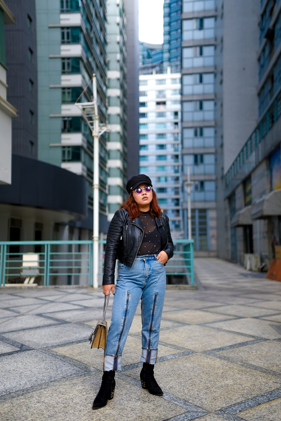 Biker Chic Vibes in Leather Jacket and Jeans