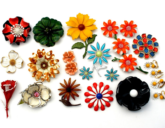 Vintage lot of enamel flower brooches can be found here