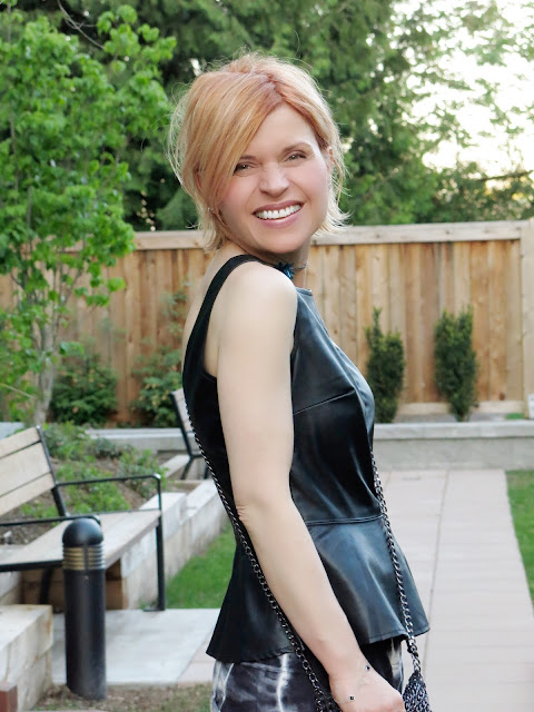 faux-leather peplum top and apricot-coloured hair!