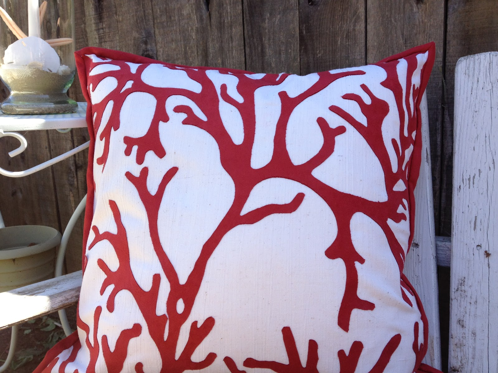 pottery barn coral pillow
