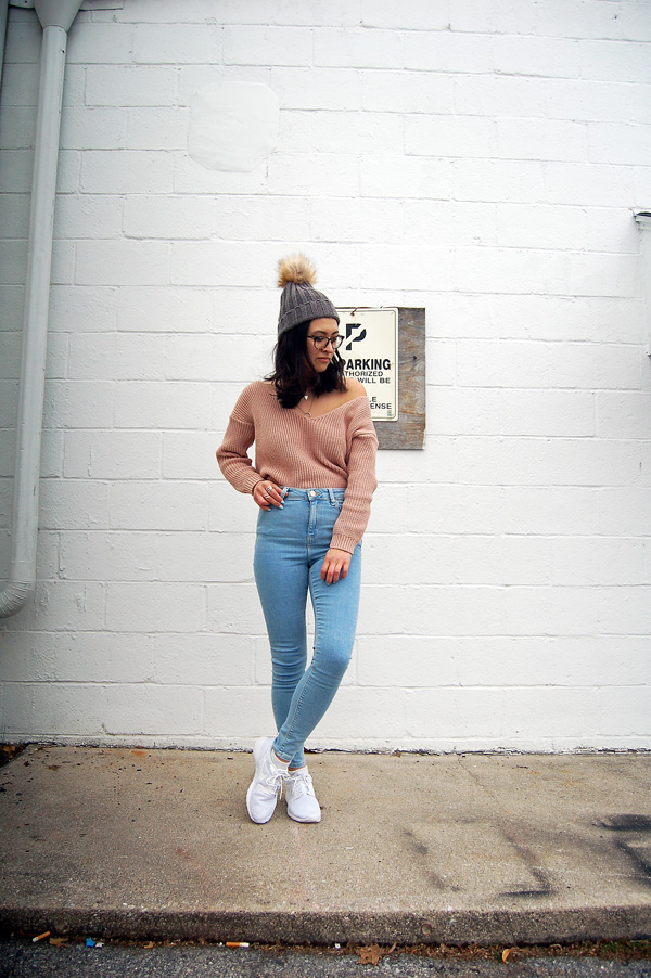pink sweater blue jeans white sneakers