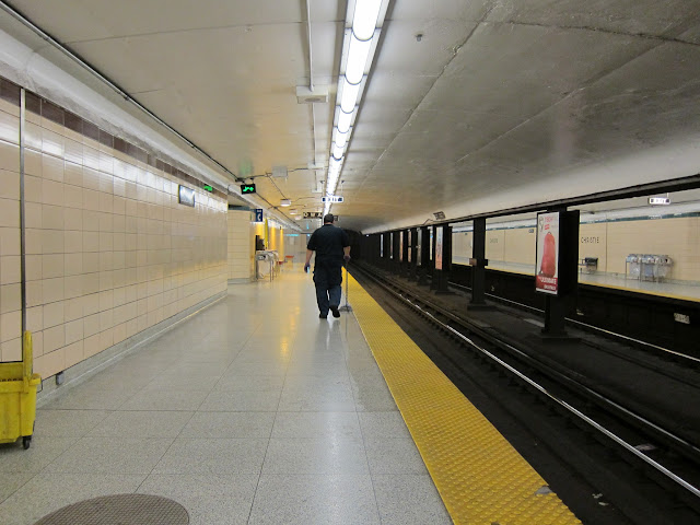 Christie station platform with TTC worker.