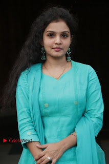 Tamil Actress Preethi Stills in Green Salwar Kameez at Kuzhalosai 2nd Anniversary Fund Raising Event  0009.jpg