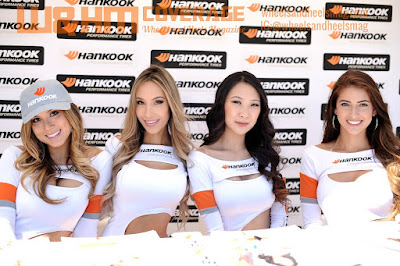 Hankook models: Erica Juliet, Alexia Cortez, Nicky Park and  Karole Priscilla in their beautiful white uniform in front of the Hankook backdrop