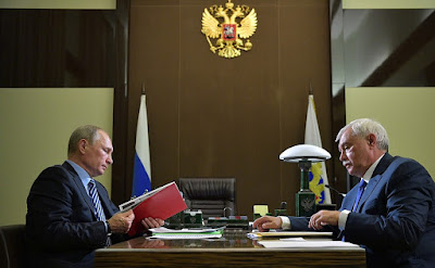 Vladimir Putin with Governor of St. Petersburg Georgy Poltavchenko.