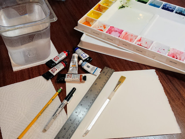 Watercolor supplies: paint palette, paint tubes, container of rinse water, pencil, permanent marker, ruler, paintbrush, paper towel, watercolor paper.