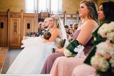 bride breastfeeding baby wedding mass