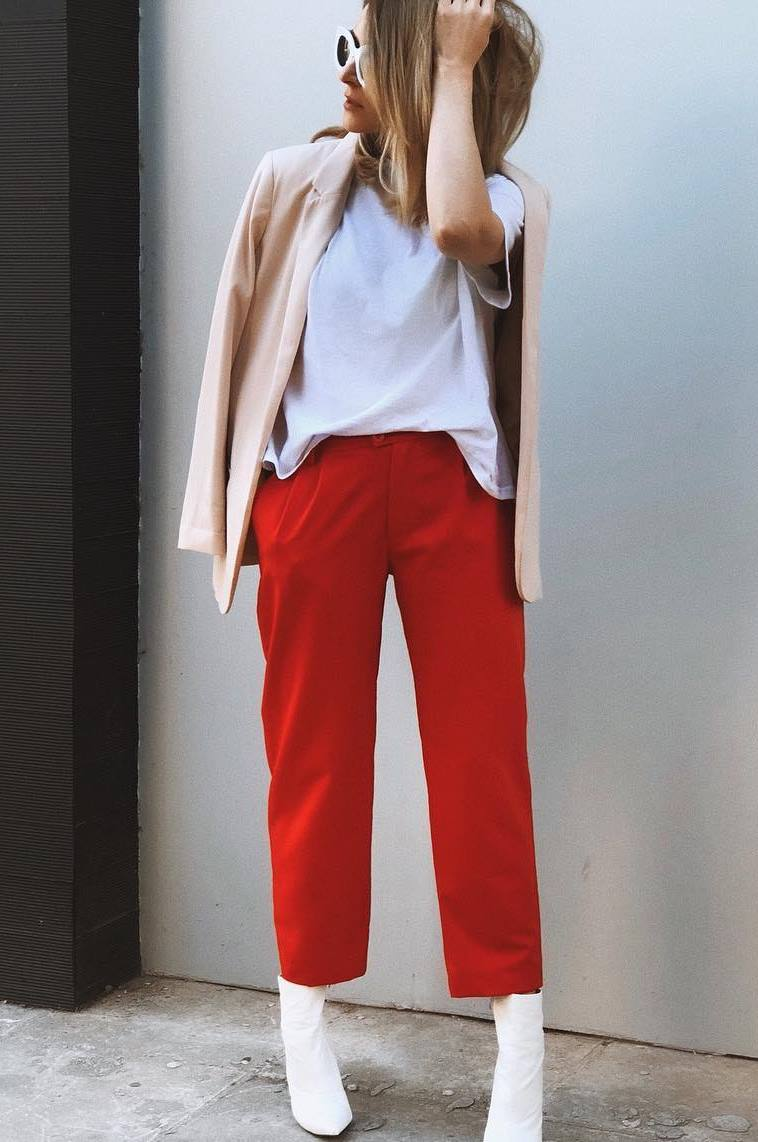 what to wear with a pair of red pants : white tee + nude coat + boots
