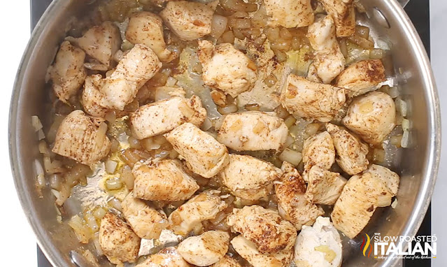 cooking diced chicken breasts in a skillet