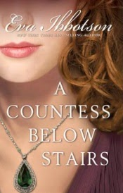 Cover of A Countess Below Stairs, featuring the lower face and upper torso of a young white woman with curly brown hair. She wears a vaguely historical purple top and has a large emerald necklace around her throat.