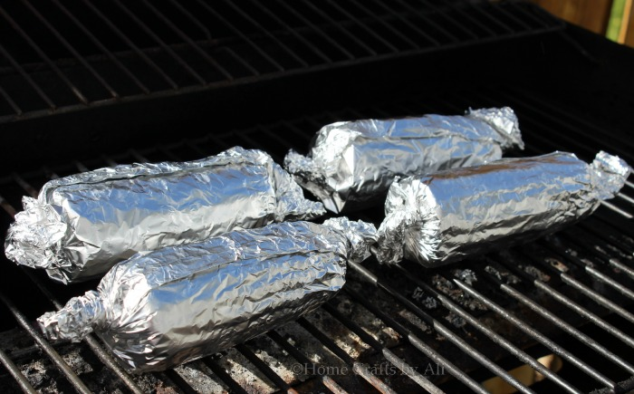 grilling corn on the cob in aluminum foil