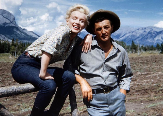 Marilyn Monroe and Robert Mitchum on the set of River of No Return (1954)