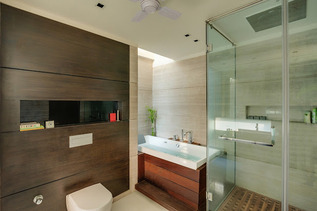 Picture of modern bathroom with dark wood on the wall