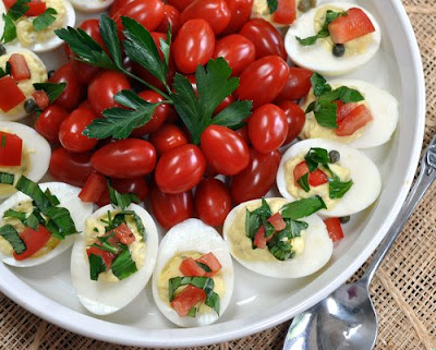 Deviled Eggs with Tomato & Herb Relish ♥ KitchenParade.com, a plain but delicious way to make deviled eggs, jazzed up in presentation with a dab of Tomato & Herb Relish and tiny tomatoes.