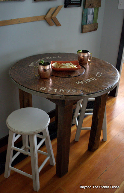 create a bar table with a reclaimed wood spool table top