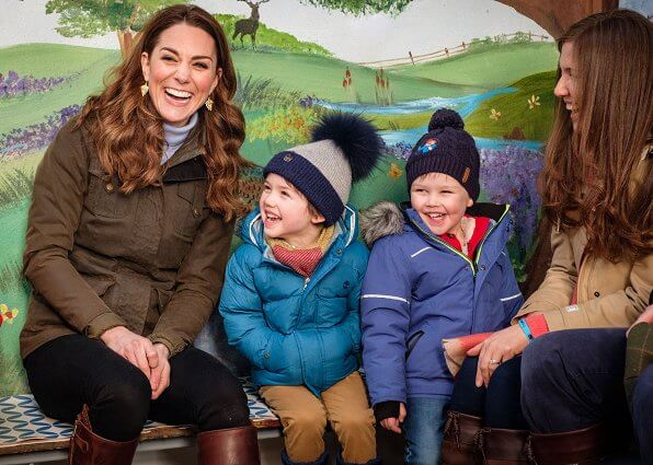 Kate Middleton wore a gray knit turtleneck, black skinny jeans, a khaki Barbour jacket, and knee-high Penelope Chilver boots